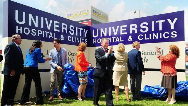 Officials unveil the new sign at University Hospital in 2014.