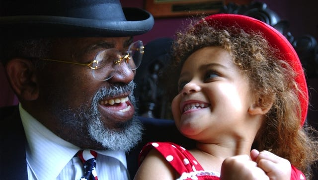 Mr. Gaines photographed in  2005 in his downtown office with his then 3-year-old daughter Maliyah J. Gaines.