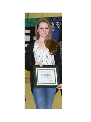 """Emma Donelson, an eighth grader, won Best in Show with her """"Musical Hens"""" Zoology project at the 2017 Pittsgrove Township Middle School Science Fair."""