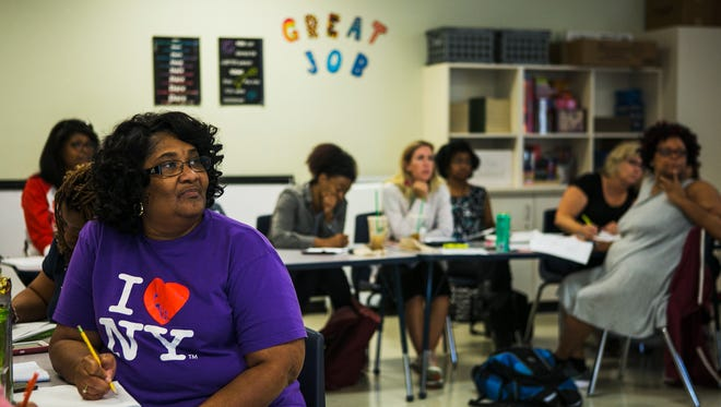 August 2, 2017 - Teacher Anita Harris listens to Lindsay Herrera (not pictured), of Shelby County Schools, professional development, during a math session at Kate Bond Middle School on Wednesday. SCS has an intense focus this summer on preparing teachers to teach content. In the days leading up to school, educators are spending full days learning the new curriculum and enforcing best practices on state standards.