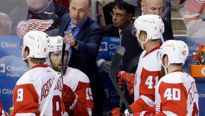 Detroit Red Wings head coach Jeff Blashill talks to the players during a timeout in the second period of an NHL hockey game against the Florida Panthers in Sunrise, Fla., Saturday, March 19, 2016. The Red Wings won 5-3.