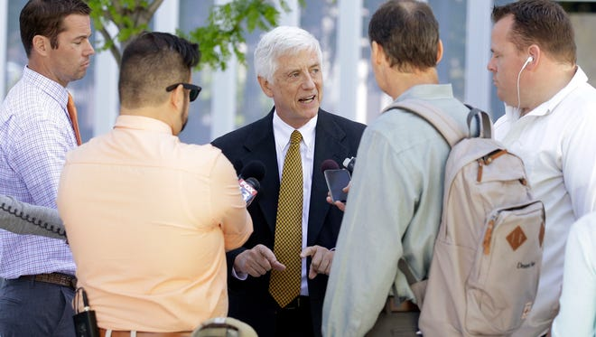 """Brewvies Cinema Pub lawyer Rocky Anderson, center, speaks with reporters outside the federal courthouse Tuesday, May 3, 2016, in Salt Lake City. The state Department of Alcoholic Beverage Control agreed in court Tuesday that officials would not cite Brewvies for any screenings with alcohol as long as the films are rated """"R"""" or less, state lawyers said during a federal court hearing in Salt Lake City."""