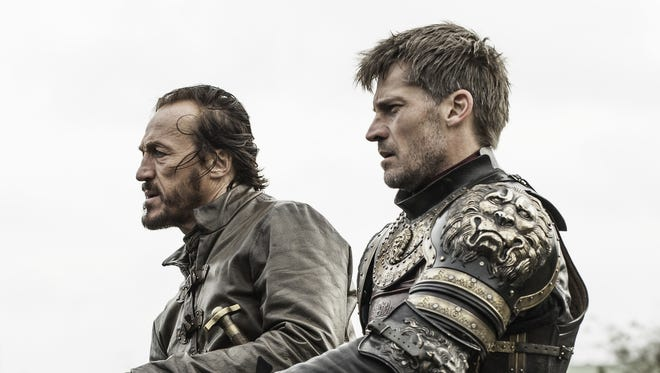Jaime Lannister (Nikolaj Coster-Waldau, right, and his lieutenant, Bronn (Jerome Flynn), are shocked to see the destruction in Kings' Landing in HBO's 'Game of Thrones.'