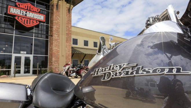 FILE- In this June 26, 2018, file photo a Harley Davidson emblem is seen on a fuel tank of a motorcycle at the Dillon Brothers Harley Davidson dealership in Omaha, Neb. Harley-Davidson, Inc. reports earnings Tuesday, Jan. 29, 2019. (AP Photo/Nati Harnik, File)