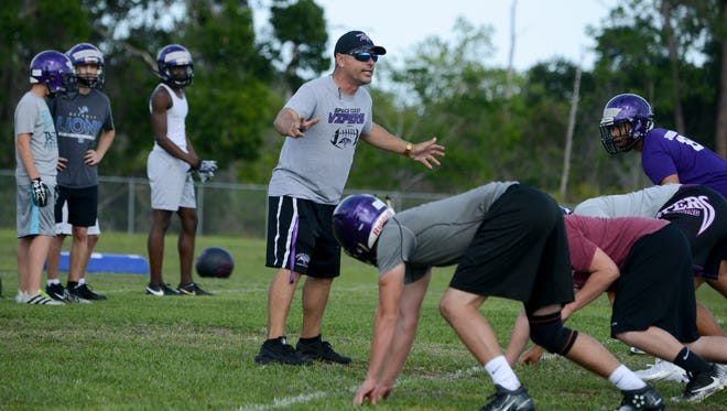 New Space Coast football coach Matt Diesel directs his team during spring practice at the school.