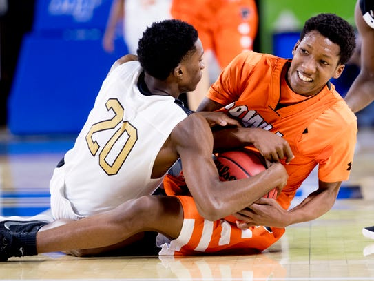 Whitehaven's Marquavious Lobbins ties up Joshua Woods. The Tigers held Powell to 35.1 percent shooting for the game and forced 22 turnovers.