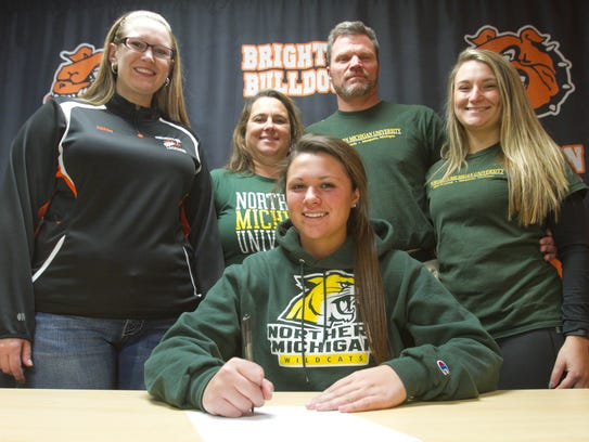 Shannon Walus of Brighton High School signs her letter