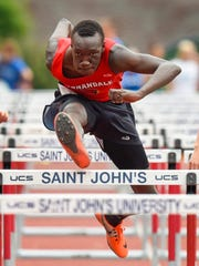 Annandale's T.J Jok clears a hurdle during the prelims of the 100-meter hurdles in the Section 5A track and field championsips Wednesday, May 30, at St. John's University in Collegeville. Jok advanced to the finals.