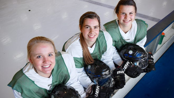 Sartell/Sauk Rapids girls hockey team players Bria Ferns, Amanda Flemming and Brooke Walters at practice Wednesday, Jan. 6 at the Bernick's Arena in Sartell.