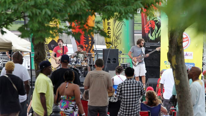 Wilmington reggae act Spokey Speaky performs at People's Festival in Wilmington's Tubman Garrett Riverfront Park.