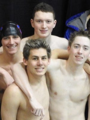 The St. Clair High School relay team of Adam George (swim cap), Evan Wonner (to his left), Christian Doenges (front left) and Tristan Fraley (front right) pose for a photo after competing in the Division 3 state finals