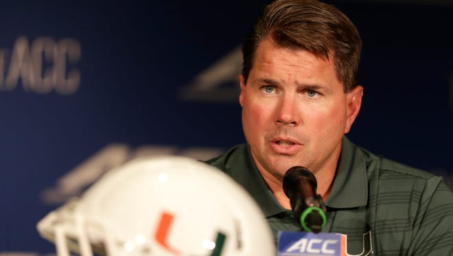 Miami head coach Al Golden answers a question during a news conference at the Atlantic Coast Conference Football kickoff in Greensboro, N.C., Monday, July 21, 2014. (AP Photo/Chuck Burton)