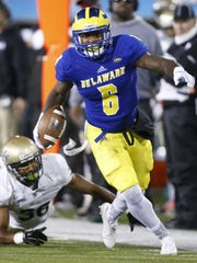 Delaware wide receiver Jamie Jarmon pushes upfield after a reception, leaving would-be William and Mary tackler DeAndre Houston-Carson behind in the second quarter at Delaware Stadium Saturday.