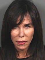 Theresa Darrah of Palm Desert is accused of selling table top advertisements through false pretenses, investigators said.