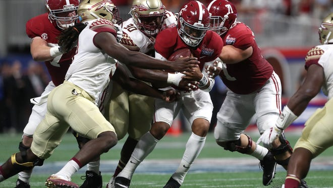 FSU's Demarcus Christmas and Josh Sweat wrap up Alabama quarterback Jalen Hurts during the Seminoles' season-opening loss in Atlanta.