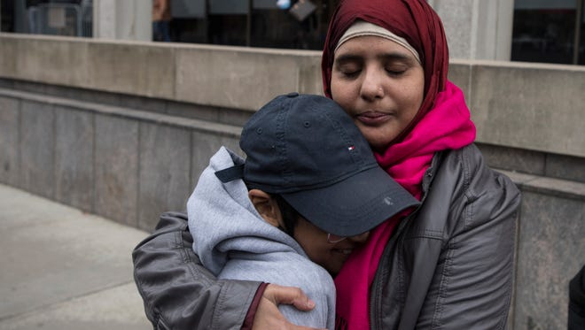 Rojina Akter, an undocumented mother of three, hugs her son Arik , 11, after her check-in with immigration authorities at the Peter Rodino Federal Building in Newark on Thursday. She was told to return in two months.