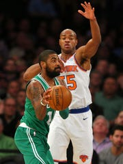 Boston Celtics point guard Kyrie Irving (11) looks to pass while defended by New York Knicks point guard Jarrett Jack (55) during the second quarter at Madison Square Garden on Thursday, Dec. 21, 2017.