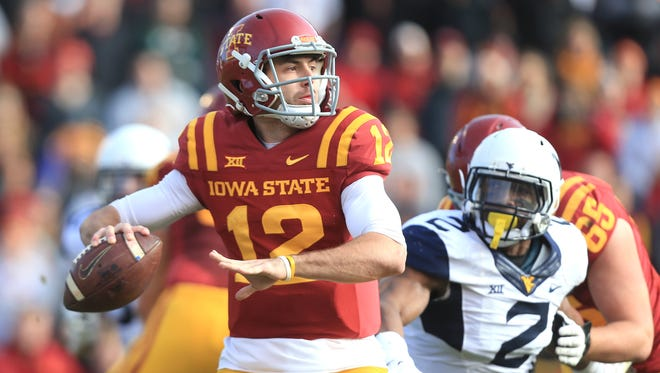 Iowa State quarterback Sam Richardson launches a pass against West Virginia on Saturday, Nov. 29, 2014, at Jack Trice Stadium in Ames, Iowa.