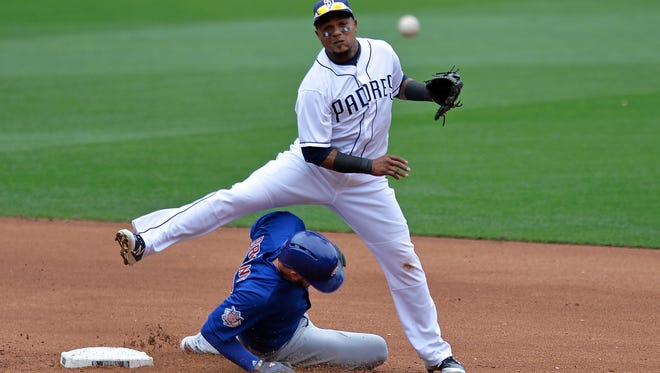 Padres shortstop Erick Aybar throws to first base after forcing out Cubs baserunner Ben Zobrist at second base during the fourth inning at Petco Park in San Diego.