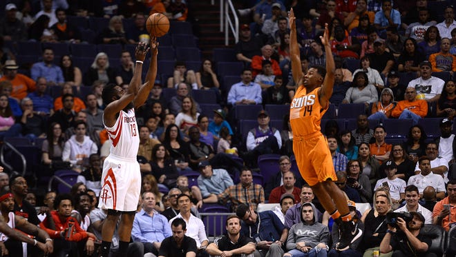 Feb 19, 2016: Houston Rockets guard James Harden (13) shoots over Phoenix Suns guard Ronnie Price (14) during the first half at Talking Stick Resort Arena.