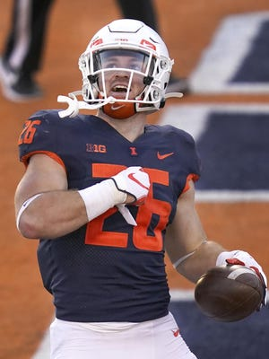 Illinois running back Mike Epstein (26) celebrates after scoring against Minnesota on Nov. 7 in Champaign, Ill.