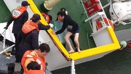 A handout image released Monday by the South Korean coast guard, taken from cellphone video footage  by a coast guard officer, shows Lee Joon-seok, the captain of the Sewol, fleeing from the sinking ferry April 16.