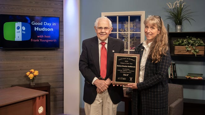 Good Day in Hudson host Frank Youngwerth presents the show's 2020 Citizen of the Year award to Hudson Community Television Programming Manager Barbara Breedon VanBlarcum. Youngwerth surprised VanBlarcum with the honor during the taping of the 20th anniversary program of Good Day in Hudson.