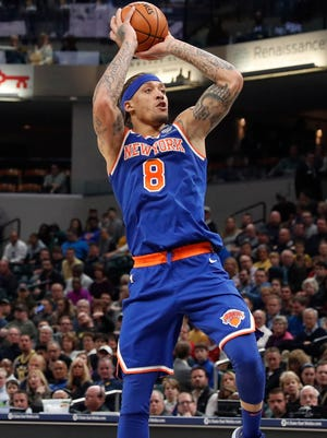 New York Knicks forward Michael Beasley (8) draws a blocking foul against Indiana Pacers forward Thaddeus Young (21) during the first quarter at Bankers Life Fieldhouse.