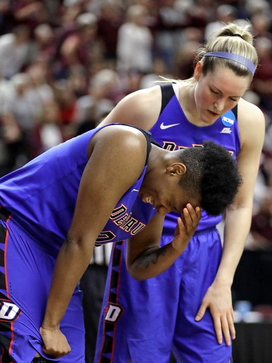 DePaul's Kelly Campbell, top, checks on Tanita Allen after Allen was fouled by Texas A&M during the second half of a second-round game in the NCAA women's college basketball tournament in College Station, Texas, Sunday, March 18, 2018. (AP Photo/David J. Phillip)