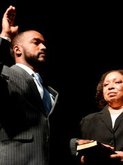 Mayor Adrian Perkins says the oath as his mother, Johnny Oliver-Jones, holds a bible during his Inauguration at the Shreveport Convention Center Saturday, Dec., 29 in Shreveport, Louisiana.