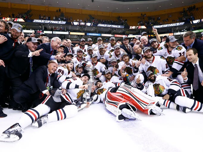 Jun 24, 2013; Boston, MA, USA; Chicago Blackhawks players and coaches pose for a photo with the Stanley Cup after game six of the 2013 Stanley Cup Final against the Boston Bruins at TD Garden. The Blackhawks won 3-2 to win the series four games to two.