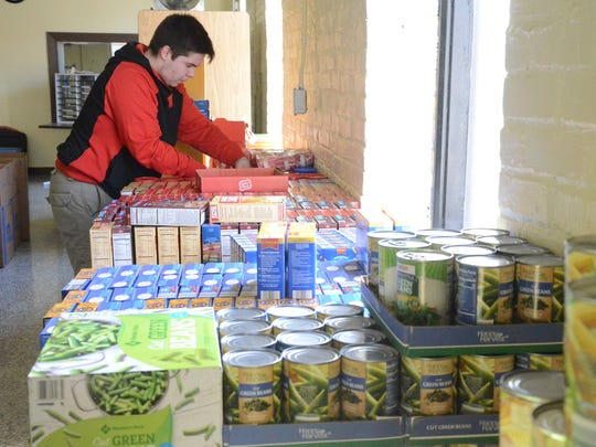 Chancelor Gillem, 15, organizes food which was distributed
