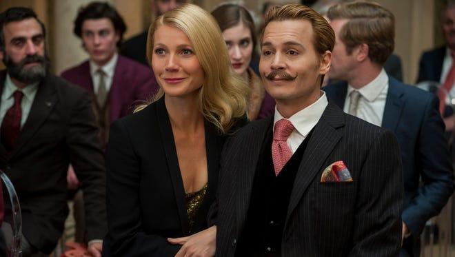 "Gwyneth Paltrow and Johnny Depp star in the comedy ""Mortdecai."""
