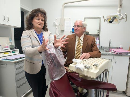 "Dentists Kim Jernigan, DMD and Walter ""Beau"" Biggs,"