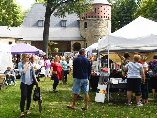 Shoppers in the museum courtyard at the Lions Arts and Crafts Festival in Henderson's Audubon State Park Saturday, October 7, 2017.