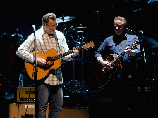 Vince Gill and Don Henley of the Eagles perform during SiriusXM presents the Eagles in their first ever concert at the Grand Ole Opry House on October 29, 2017 in Nashville, Tennessee.  (Photo by Kevin Mazur/Getty Images for SiriusXM)