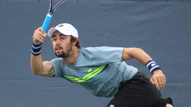 Top-seeded Jordan Thompson follows through on a return shot during singles play at a past Levene Gouldin & Thompson Tennis Challenger at Recreation Park in Binghamton.