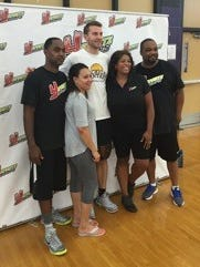 Nik Stauskas poses with campers Monday in Ann Arbor.
