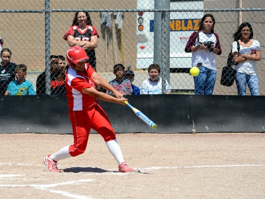 Loving's Andrica Gomez hits an RBI-triple during game