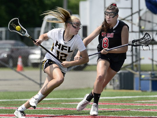 The Canandaigua stop on the Shootout for Soldiers schedule will feature male and female teams of all skill level. Here, HF-L's Kieran Ratliff, left, drives past a Mount Sinai defender during the 2017 NYSPHSAA Girls Lacrosse Championships Class C final at SUNY Cortland in Cortland, N.Y. on Saturday, June 10, 2017.