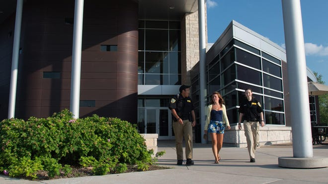 University of Wisconsin-Oshkosh community service officers participate in the Safewalk program in this undated file photo. The program provides trained escorts for students on campus during the evening and night hours.