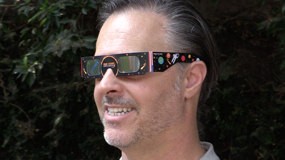 Astro-photographer Brian Valente sports filtered glasses