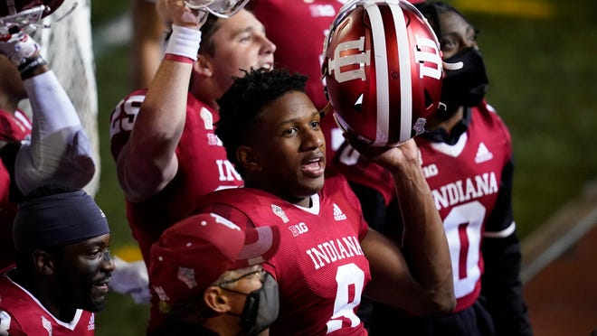Indiana quarterback Michael Penix Jr. (9) celebrates after Indiana defeated Penn State in overtime on Saturday.