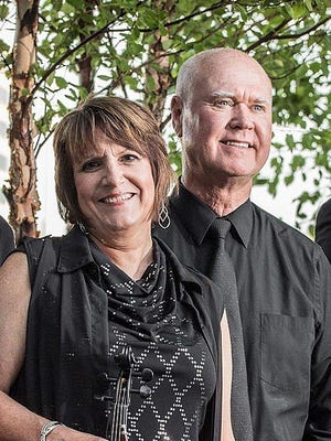Julie Moore, left, and her husband, Chris Moore, of Tennessee Backporch, will be hosting a two-hour variety show on WQLN-FM/91.3 FM in which they'll  play music and feature other local musicians.