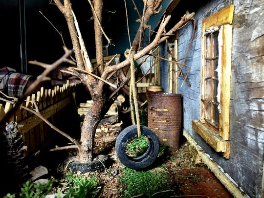 A tire swing hangs from a tree in the Plantation House diorama created by  Jother Woods, 86, of Detroit. This section of the diorama depicts the sharecropper's house that he grew up in.
