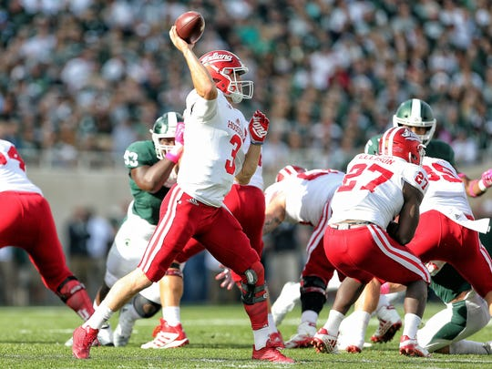 Indiana Hoosiers quarterback Peyton Ramsey (3) attempts to throw the ball against the Michigan State Spartans during the first quarter of a game at Spartan Stadium. Mike Carter-USA TODAY Sports
