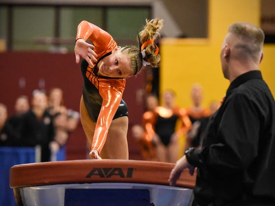 Tech's Kate Schmitz competes on the vault during the