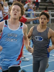 Reed Greenwell focuses on completing the race. Greenwell came in 6th of 14 in the boys 1600 meter run with a time of 5:30.4