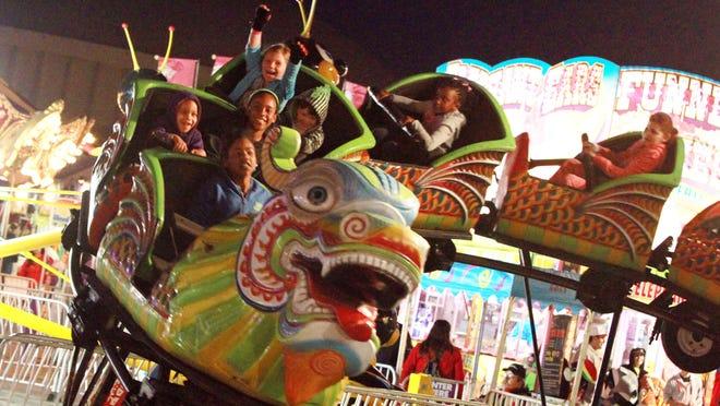 Kids enjoy a roller coaster ride during the 2014 Festival de Mardi Gras a' Lafayette at Cajun Field.