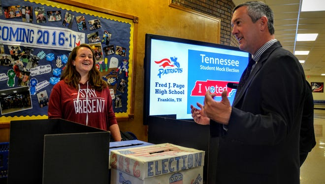 Tennessee Secretary of State Tre Hargett, right, talks with Page High School students who are volunteering for a mock election.
